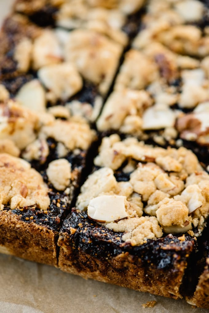 Side view, homemade fig bars cut into squares.