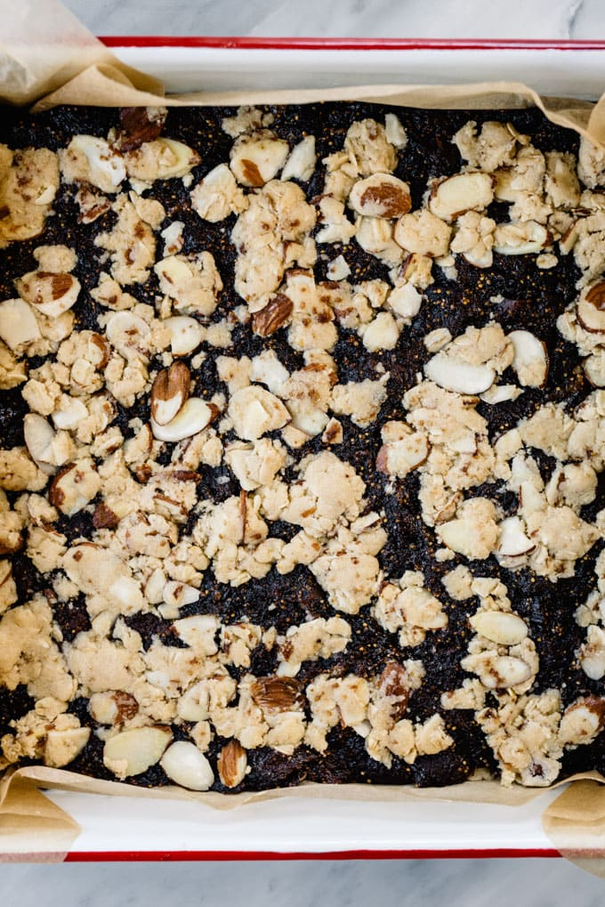Fig bars layered into a baking dish ready to be baked.