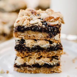 A stack of homemade fig bars on a white plate.