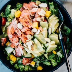 From above, salmon and avocado salad with mango and lemon dressing.