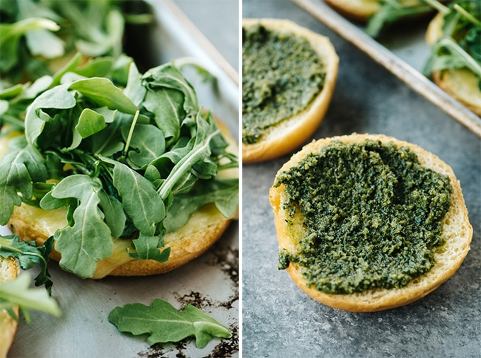 Right - Arugula piled onto a brioche bun. Left - Pesto sauce slathered on a brioche bun.