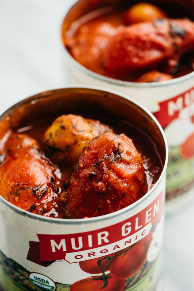 Two large cans of whole fire roasted tomatoes.